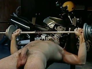 gay hunk does some exercise nude inside the garage