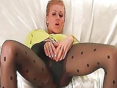turned on blonde in black pantyhose sticks dildo