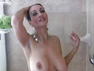 brunette mature babe with giant tits pleases