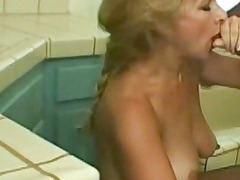 awesome mature blonde enjoys brown penis