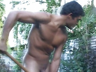 muscular gay guy works into the garden showed