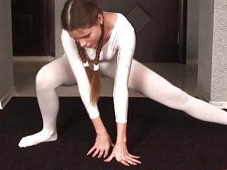 flexible brunette young with braids inside