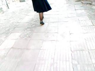 older  lady walking into brown shoes